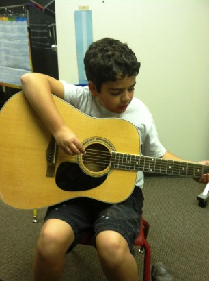 Carson with guitar